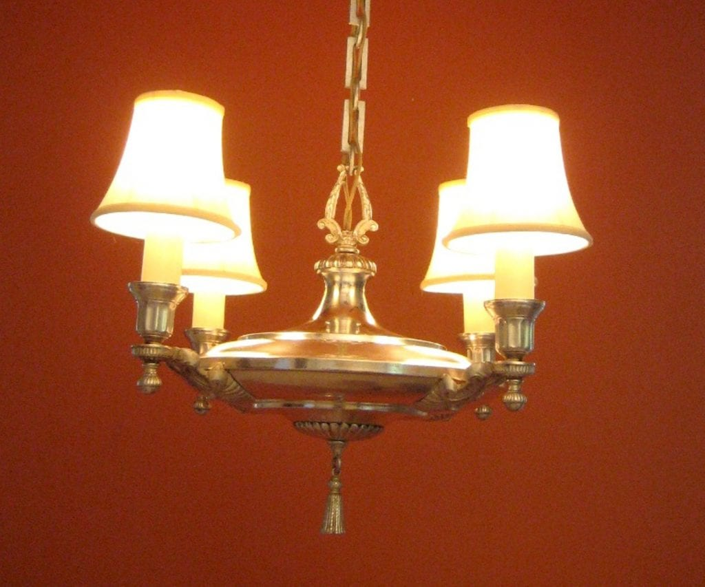 1920s Colonial-Revival silver SET. One chandelier. Four sconces.