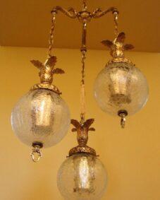 1960s Hollywood-Regency tri-globe chandelier. Extraordinary.