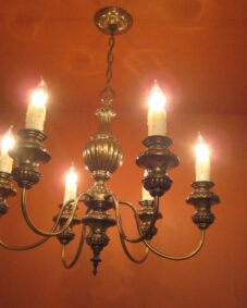 1970s colonial-style chandelier by Moe. Very large 25 wide.