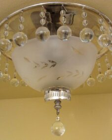 Exquisite circa-1940 crystal fixture. Ideal for foyer or powder room.