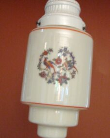 FOUR 1930s Porcelier fixtures including pair of sconces.