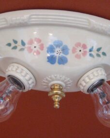 FOUR 1930s porcelain lights by Porcelier including a pair of sconces. Ideal for a kitchen