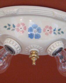 FOUR 1930s porcelain lights by Porcelier including a pair of sconces. Ideal for a kitchen
