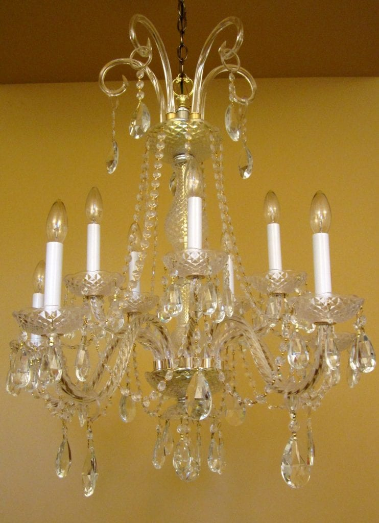 Large 26-wide crystal chandelier with 10 lights.