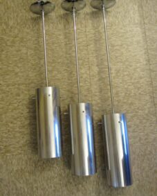 THREE mod 1970s aluminum pendants by Habitat.
